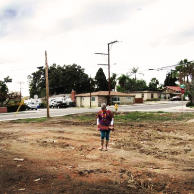 Brenda Hammond takes a walk through the plot of land that will be turned into the Lemon Grove Community Garden.