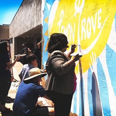 Students in SDSU's Sage Project and Lemon Grove community members painted a mural on the side of the Lemon Grove Recreation Center.